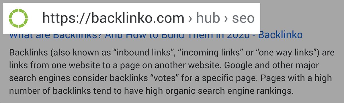 URL acima do título no SERP móvel